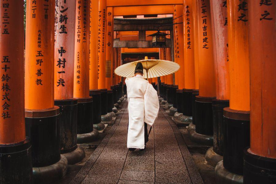 a Japanese man holding an umbrella