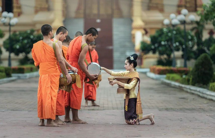 A monk giving charity